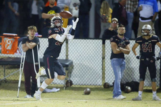 Cashion's Landon Lagasse catches a pass for a touchdown during a Nov. 6 district game against Crescent. [Bryan Terry/The Oklahoman]