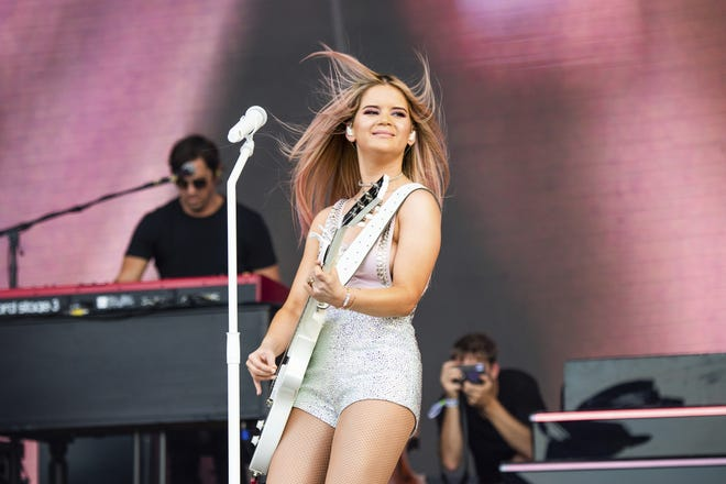 """Maren Morris, seen here in 2019, earned three CMA Awards Wednesday night: Song of the Year, Single of the Year for hit song """"The Bones,"""" and Female Artist of the Year. [Amy Harris/Invision/AP, File]"""