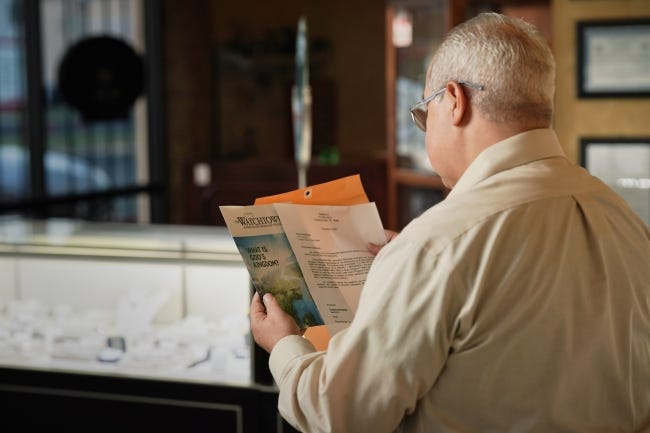"""Oklahoma Jehovah's Witnesses have joined Jehovah's Witnesses around the world in a November campaign to distribute a special issue of the Watchtower magazine entitled """"What Is God's Kingdom?""""[Photo provided]"""