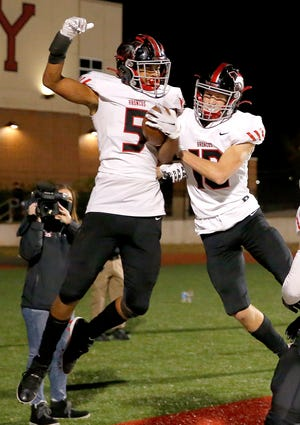 Mustang's Dominique Dunn (5) celebrates a touchdown with Rylan Poteet (10) during the high school football playoffs between Yukon and Mustang at Yukon High School in Yukon, Okla. Friday, Nov. 13, 2020. [Sarah Phipps/The Oklahoman]