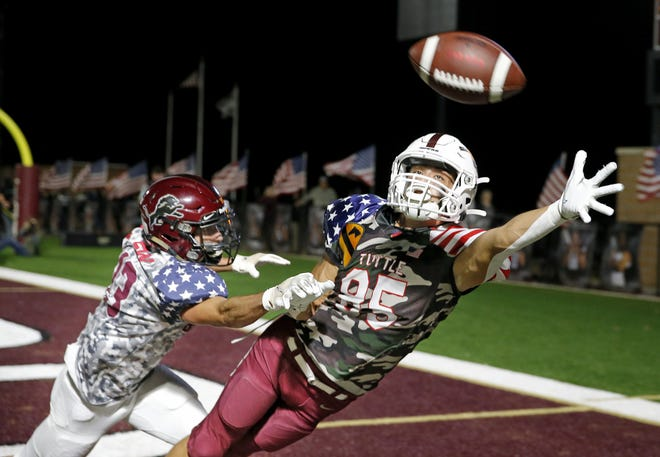 Tuttle's Hunter Anderson can not make a reception as Blanchard's Lincoln Smith defends during last week's game in Blanchard. [Sarah Phipps/The Oklahoman]