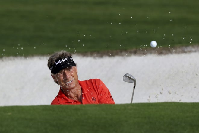 Bernhard Langer hits out of a bunker on the ninth hole Friday to finish his first round of the Masters in Augusta, Ga. [Curtis Compton/Atlanta Journal-Constitution via AP]