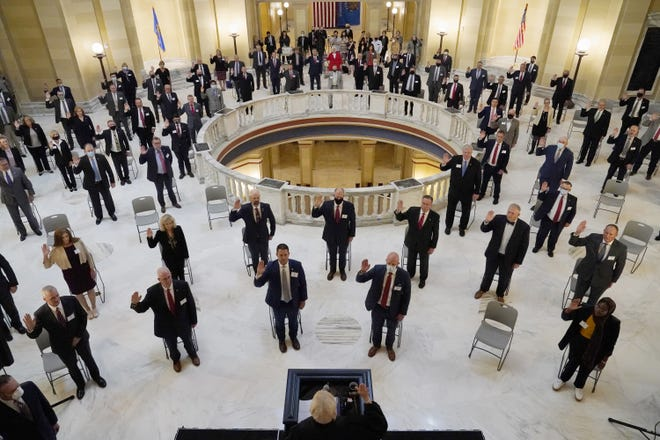 House members participate in a ceremonial swearing-in ceremony Wednesday at the state Capitol in Oklahoma City. The senate has canceled its planned Monday ceremony due to concerns about COVID-19. [AP PHOTO]