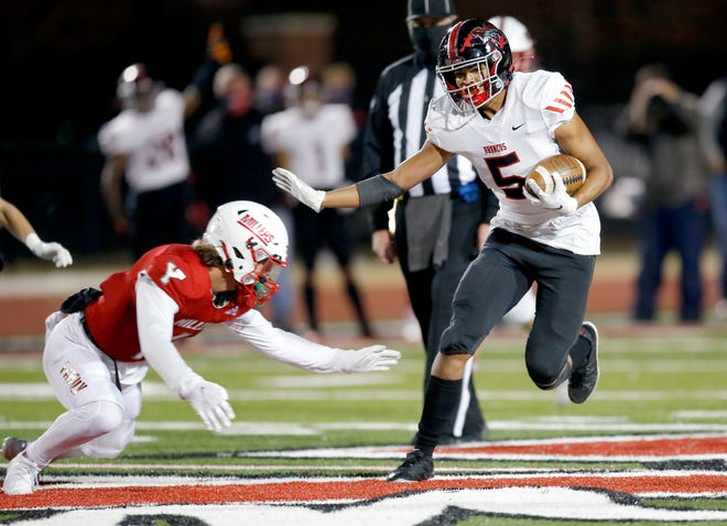Mustang's Dominique Dunn, right, tries to get past Yukon's Luke Harris during Friday's game in Yukon. [Sarah Phipps/The Oklahoman]