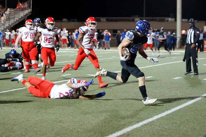 Newcastle's Justus Conway runs past John Marshall's Charles Carter to score a touchdown during a high school football playoff game between Newcastle and John Marshall in Newcastle, Okla., Friday, Nov. 13, 2020. [Bryan Terry/The Oklahoman]
