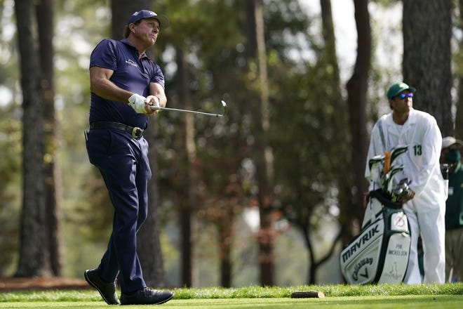 Phil Mickelson watches his drive on the fourth tee during the third round of the Masters golf tournament on Saturday in Augusta, Ga. [AP Photo/David J. Phillip]
