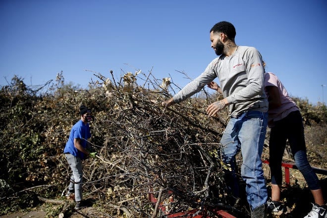 Eddie Burghart with Inspirations and Restoration drops off a customer's tree debris Saturday from the recent ice storm at the Hafer Park in Edmond. [Sarah Phipps/The Oklahoman]