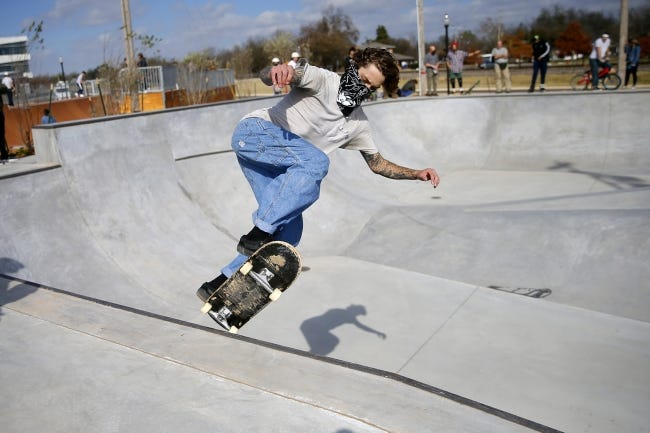Damian Schroeder rides his skateboard after Saturday's opening and ribbon cutting ceremony for the new Blake Baldwin Skate Park at Andrews Park in Norman. [Bryan Terry/The Oklahoman]