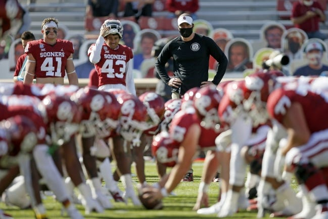 OU defensive coordinator Alex Grinch (center) watches the Sooners warm up before a 62-9 win over Kansas on Nov. 7 at Gaylord Family-Oklahoma Memorial Stadium in Norman. [Bryan Terry/The Oklahoman]