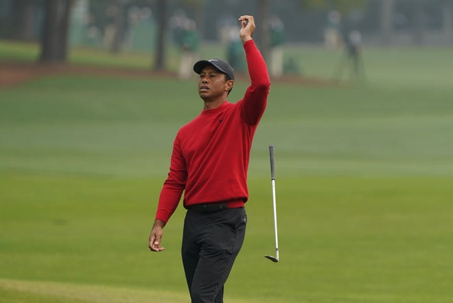 Tiger Woods reacts after a near chip in on the second hole during the final round of the Masters. [AP Photo/Chris Carlson]