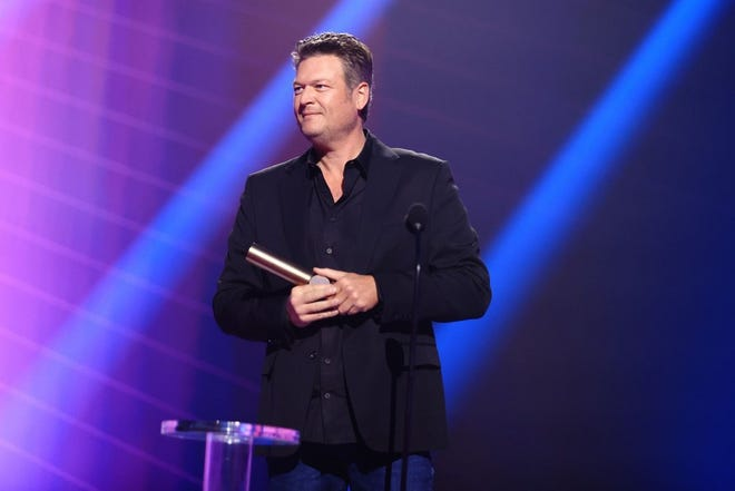 Blake Shelton, the Country Artist of 2020, accepts the award onstage for the 2020 E! People's Choice Awards at the Barker Hangar in Santa Monica, California and on broadcast on Sunday, November 15, 2020. [Photo by Christopher Polk/E! Entertainment]