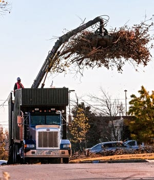 Crews for the City of Oklahoma City work to clean up tree debris left behind from the Oct. ice storm near NW 22nd St. and N. Classen Blvd. in Oklahoma City, Okla. on Monday, Nov. 16, 2020. [Chris Landsberger/The Oklahoman]