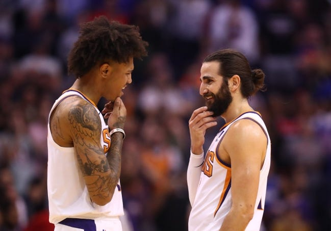 Phoenix Suns foreword Kelly Oubre Jr. (left) celebrates with guard Ricky Rubio against the Philadelphia 76ers in the closing seconds of a game at Talking Stick Resort Arena. Oubre and Rubio were traded to Oklahoma City on Monday. [Mark J. Rebilas-USA TODAY Sports]