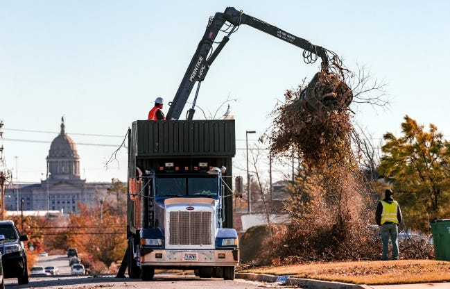 Crews for the City of Oklahoma City work to clean up tree debris left behind from the October ice storm near NW 22 and Classen. City officials say about 10 percent of the debris has been picked up so far. [Chris Landsberger/The Oklahoman]