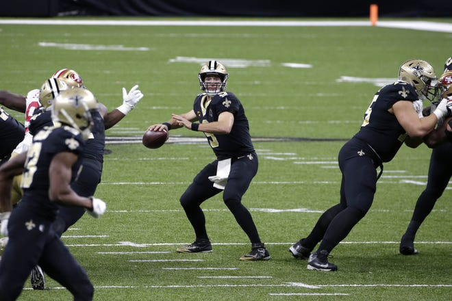 Saints quarterback Drew Brees (9) drops back to pass against the 49ers in New Orleans. Brees has been diagnosed with multiple rib fractures and a collapsed right lung. [AP Photo/Butch Dill]