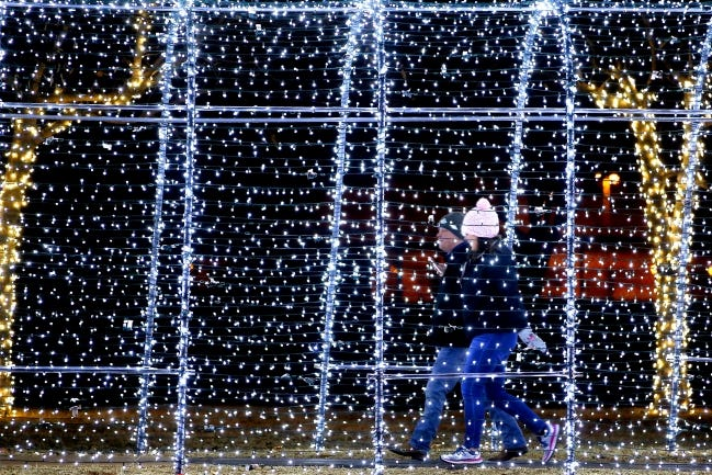 Visitors to Edmond's Mitch Park walk through a light display during a previous year's Luminance event. [BRYAN TERRY/THE OKLAHOMAN ARCHIVES]