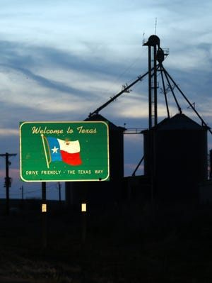 A sign welcomes drivers to Texas at the end of Oklahoma's State Highway 33 on the edge of western Oklahoma. [THE OKLAHOMAN ARCHIVES]