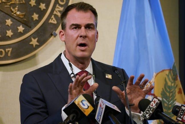 Gov. Kevin Stitt speaks during a news conference Monday. [AP Photo/Sue Ogrocki]