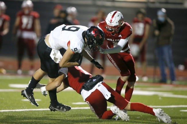 Westmoore's Zane Chavez is brought down by Yukon's Luke Harris, bottom and Riley King during a game on Oct. 30. [Bryan Terry/The Oklahoman]
