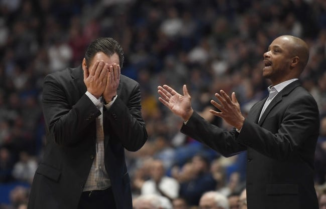 Wichita State coach Gregg Marshall, left, resigned Tuesday following an investigation into allegations of verbal and physical abuse, ending a tenure that soared to the Final Four and crashed on the eve of the upcoming season. Shockers assistant coach Isaac Brown, right, will serve as the interim coach. [AP Photo/Jessica Hill, File]