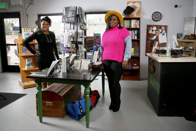 Kenyetta Richard and Courtney Strickland pose for a photo inside their new store, Belle Books Boutique & More, 1742 NE 23 Suite 8 in Oklahoma City. [Bryan Terry/The Oklahoman]