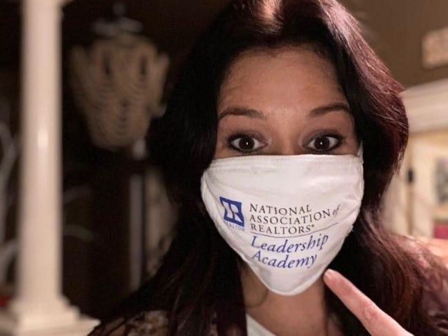 Becky Karpe dons a National Association of Realtors Leadership Academy mask. [PHOTO PROVIDED]