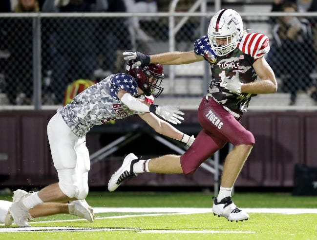 Tuttle's Mason Stokes runs after a reception as Blanchard's Whit Carpenter during a game on Nov. 6. [Sarah Phipps/The Oklahoman]