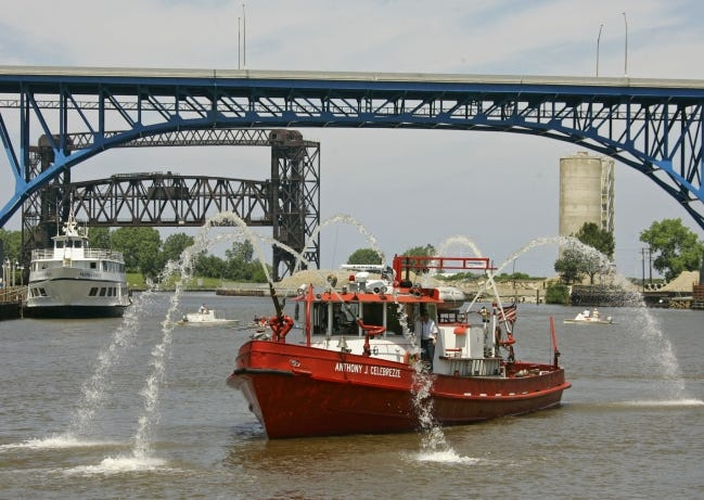 The Cleveland Fire Department fire boat sprays water on the Cuyahoga River in Cleveland, Ohio, during a previous year's observance of a historic river fire. On June 22, 1969, floating oil and debris caught fire on the river helping spur an environmental movement and the federal Clean Water Act. [MARK DUNCAN/ASSOCIATED PRESS FILE PHOTO]