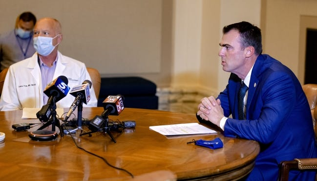 Governor Kevin Stitt and Commissioner of Health Lance Frye answer questions regarding COVID-19 during a press conference at the Oklahoma state Capitol in Oklahoma City on Thursday. [Chris Landsberger/The Oklahoman]
