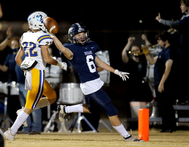 El Reno's Cole Mitchell celebrates a touchdown in front of Piedmont's Jacob Anglin during the high school playoff football game between El Reno and Piedmont int El Reno, Okla., Friday, Nov. 20, 2020. [Sarah Phipps/The Oklahoman]