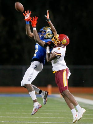 Choctaw's Jordan Mukes tries to intercept a pass intended for Putnam City North's Jeff Nwankwo during a high school football game between Choctaw and Putnam City North at Choctaw, Okla., Friday, Nov. 20, 2020. [Bryan Terry/The Oklahoman]