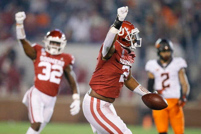 Oklahoma's David Ugwoegbu (2) celebrates after an interception during a bedlam college football game between the University of Oklahoma Sooners (OU) and the Oklahoma State Cowboys (OSU) at Gaylord Family-Oklahoma Memorial Stadium in Norman, Okla., Saturday, Nov. 21, 2020. [Bryan Terry/The Oklahoman]