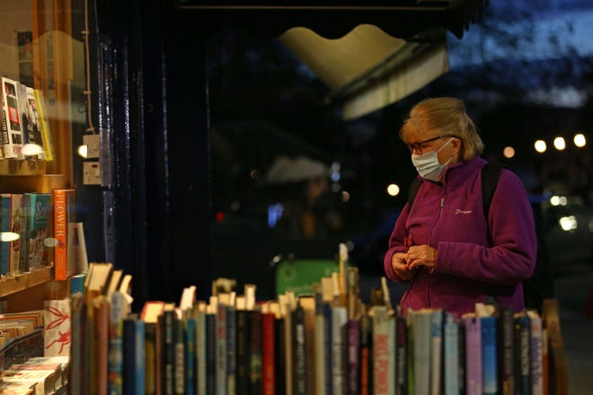 Booksellers are anticipating shortages of popular books, and delays in getting shipments due to COVID-19 pandemic. [Hollie Adams/AFP via Getty Images/TNS]