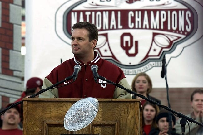 OU coach Bob Stoops addresses the crowd at the Sooner Championship Celebration program in Norman on Jan. 21, 2001. Stoops retired in 2017 after 18 seasons and 10 Big 12 Conference titles. [AP Photo/J. Pat Carter]