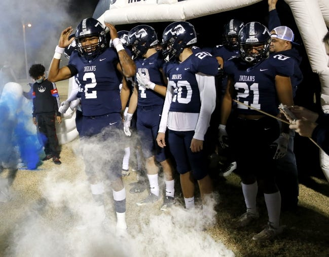 El Reno's Dorian Plumley (2) waits to run onto the field before last Friday's Class 5A playoff game against Piedmont in El Reno. [Sarah Phipps/The Oklahoman]