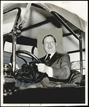 Fred Jones is shown trying out the 1916 model Ford presented to him by employees in 1956, the 40th anniversary of his association with the automobile company. [PROVIDED BY THE OKLAHOMA HISTORICAL SOCIETY]