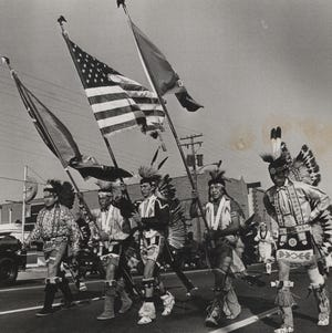 """A student color guard from Chilocco Indian School leads a parade in conjunction with the 23rd annual convention of the National Congress of American Indians in November 1966. The gathering was at the Sheraton-Oklahoma Hotel in downtown Oklahoma City and included representatives from 125 American Indian tribes. The Congress voted on resolutions seeking equal job opportunities for Indians, self-determination in tribal matters and more federal aid at the grassroots level without federal controls. The event also featured a panel discussion on """"Indians and Their Environment."""" Among other highlights were the parade, a barbecue and a ceremonial dance exhibition. Chilocco Indian School was located about 20 miles north of Ponca City. [JIM LUCAS/THE OKLAHOMAN ARCHIVES]"""