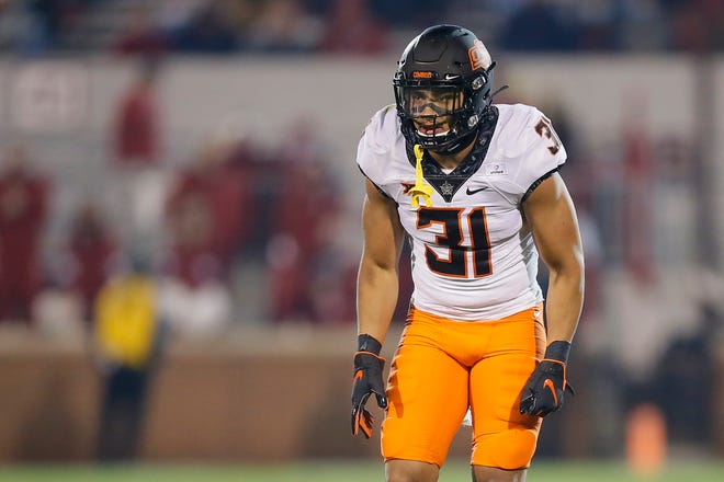 Oklahoma State's Kolby Harvell-Peel (31) lines up during a Bedlam college football game between the University of Oklahoma Sooners (OU) and the Oklahoma State Cowboys (OSU) at Gaylord Family-Oklahoma Memorial Stadium in Norman, Okla., Saturday, Nov. 21, 2020. Oklahoma won 41-13. [Bryan Terry/The Oklahoman]