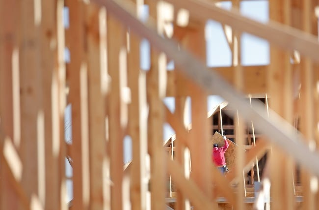 A construction worker frames a house at 19720 Bolton Drive being built by Home Creations, in the Castleberry addition, north of NW 192 and east of N May Avenue. [SARAH PHIPPS/THE OKLAHOMAN]