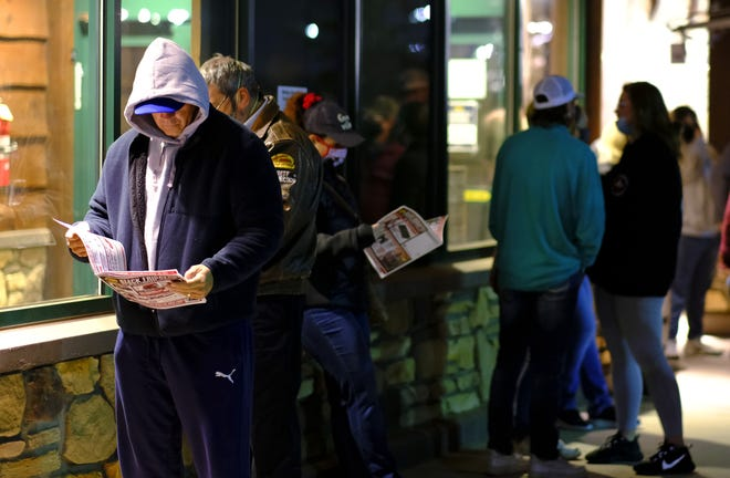 Customers wait in line for the 5 a.m. opening of Cabela's for Black Friday sales Friday. [Doug Hoke photos/The Oklahoman]