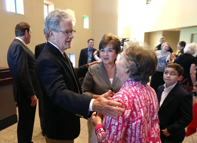 Carolyn Coburn, center, the wife of the late Sen. Tom Coburn left, was recently charged more than $2,700 for a COVID-19 test. [MATT BARNARD/Tulsa World archives]