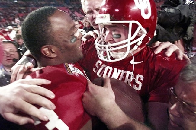 Oklahoma quarterback Josh Heupel hugs Josh Norman after winning the Orange Bowl and the national championship by defeating Florida State 13-2 on Jan. 3, 2001, in Miami. [Robert Deutsch/USA TODAY]