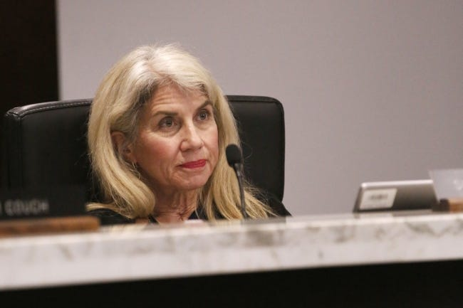 Sue Ann Arnall watches a member of the public speak during an Oklahoma County Jail Trust meeting in July. [Paxson Haws/The Oklahoman]