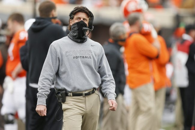 Oklahoma State coach Mike Gundy wants his players to wear their masks and keep their distance as much as possible, but he knows that can't eliminate all the COVID risks. [Bryan Terry/The Oklahoman]