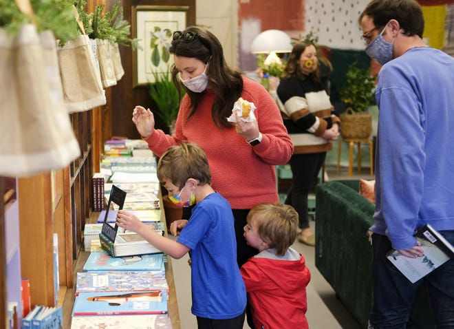 Katy and Brody Gustasson look for a book for their boys, Park, 6, and Guy, 2, at Commonplace Books in downtown Edmond during Small Business Saturday. [Doug Hoke/The Oklahoman]