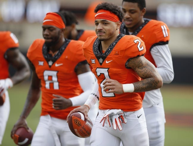 Oklahoma State wide receiver Tylan Wallace (2) could be selected as high as the second round in next month's NFL Draft. [Bryan Terry/The Oklahoman]