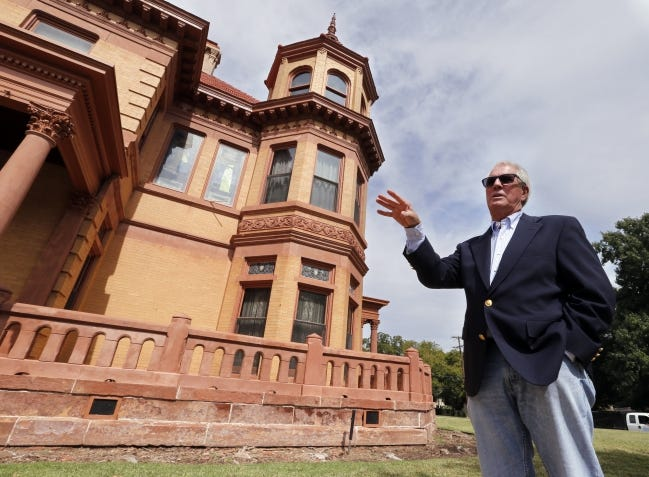 Bill Gumerson explains exterior repairs he oversaw at the Overholder Mansion in this 2014 photo. He is credited with saving the city's oldest mansion as a historic landmark for future generations to learn about the city's past. [OKLAHOMAN ARCHIVES]