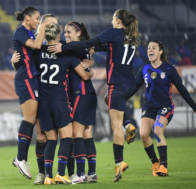 United States players celebrate with Kristie Mewis, number 22, who scored her side's second goal during the international friendly women's soccer match between The Netherlands and the US at the Rat Verlegh stadium in Breda, southern Netherlands, Friday Nov. 27. [Piroschka van de Wouw/Pool via AP]