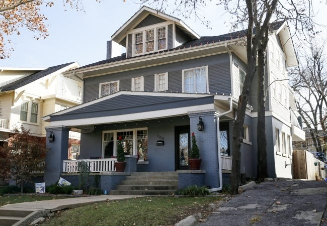 Andy and Jennifer Bowman's American Foursquare-style home at 704 NW 18, built in 1912, provided the refreshment porch for the 2019 Mesta Park Holiday Home Tour. [THE OKLAHOMAN ARCHIVES]