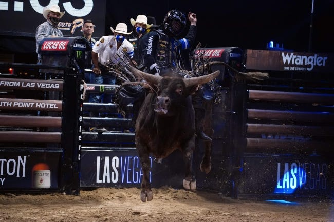 Sage Kimzey rides bull Crossfired during the PBR Monster Energy Team Challenge at South Point Arena in Las Vegas on June 4. [Kirby Lee/USA TODAY Sports]
